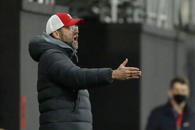 Liverpool's manager Jurgen Klopp gestures during the English Premier League soccer match between Fulham and Liverpool, at Craven Cottage stadium, London, Sunday, Dec. 13, 2020. (AP photo/Matt Dunham, Pool)