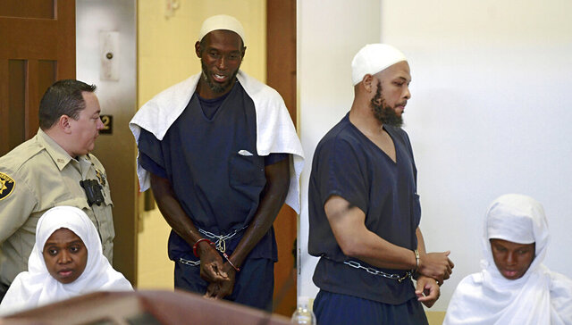 FILE - In this Aug. 13, 2018, file photo, defendants, from left, Jany Leveille, Lucas Morton, Siraj Ibn Wahhaj and Subbannah Wahhaj enter district court in Taos, N.M. A judge has ordered the hospitalization for mental health treatment of a second member of an extended family confronting firearms, kidnapping and terrorism-related charges. The case stems from a 2018 raid on a remote compound in New Mexico where a child's decomposed body was discovered. Court records on Tuesday, Aug. 11, 2020, show 42-year-old Lucas Morton was found incompetent to stand trial by a federal judge and should be committed to a medical center for treatment. (Roberto E. Rosales/The Albuquerque Journal via AP, Pool, File)
