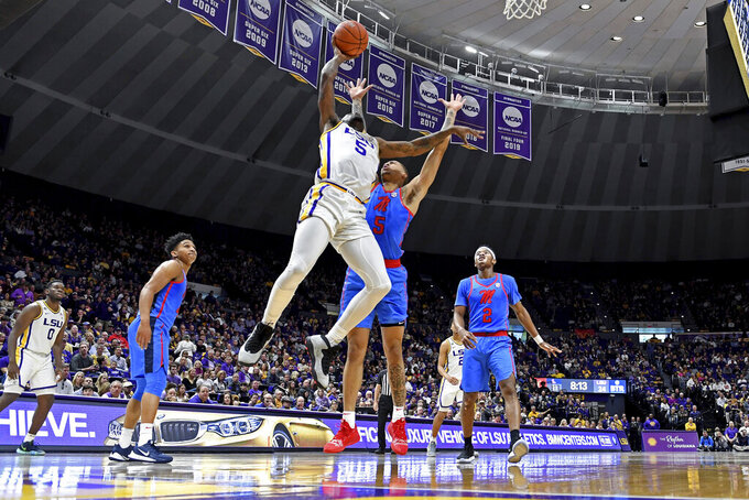 LSU forward Emmitt Williams (5) puts the ball up for two points as Mississippi forward KJ Buffen (5) defends in the first half of an NCAA college basketball game, Saturday, Feb. 1, 2020, in Baton Rouge, La. (AP Photo/Bill Feig)