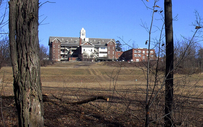 FILE - This Feb. 22, 2015 file photo shows buildings and property of Burlington College in Burlington, Vt. Prior to housing the college, the building was home to St. Joseph's Orphanage. The Vermont Senate on Tuesday, April 20, 2021 passed a proposal to eliminate the statute of limitations in civil cases of childhood physical abuse. The proposal that passed was pushed by a group of now-aging people who say they suffered physical abuse while living at the St. Joseph's Orphanage in Burlington, which closed in 1974. (AP Photo/Wilson Ring, File)