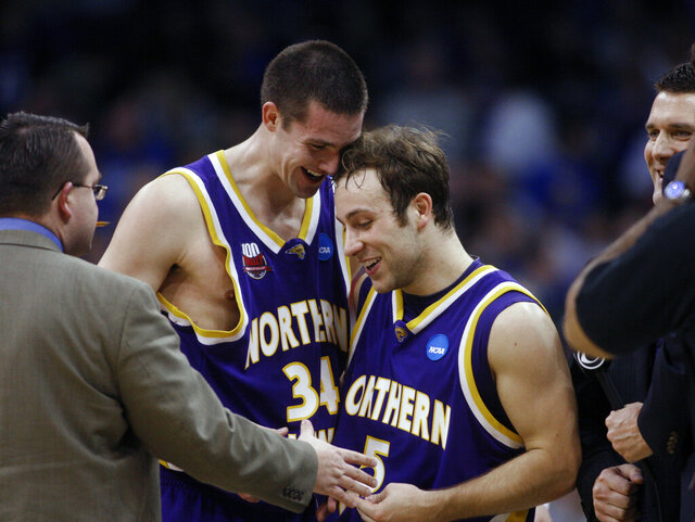 FILE - In this March 18, 2010, file photo, Northern Iowa forward Adam Kock (34) congratulates teammate Ali Farokhmanesh after an NCAA first-round college basketball game against UNLV, in Oklahoma City. This is the time of year that people will usually start tweeting at Ali Farokhmanesh. There will be Northern Iowa fans that remember his back-to-back buzzer-beaters to beat UNLV and Kansas and usher the Panthers to the Sweet 16 of the NCAA Tournament a decade ago.  (AP Photo/Sue Ogrocki, File)