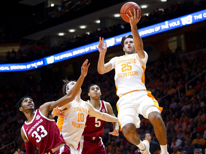 Tennessee guard Santiago Vescovi (25) attempts a shot during an NCAA college basketball game against Arkansas, Tuesday, Feb. 11, 2020 in Knoxville, Tenn. (Brianna Paciorka/Knoxville News Sentinel via AP)