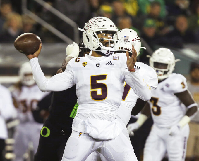 Arizona State quarterback Manny Wilkins throws down field against Oregon during the second quarter of an NCAA college football game Saturday, Nov. 17, 2018, in Eugene, Ore. (AP Photo/Chris Pietsch)