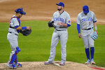 Chicago Cubs starting pitcher Jon Lester, center, catcher Willson Contreras, left, and third baseman Kris Bryant wait for pitching coach Tommy Hottovy during the fourth inning of the team's baseball game against the Chicago White Sox in Chicago, Saturday, Sept. 26, 2020. (AP Photo/Nam Y. Huh)