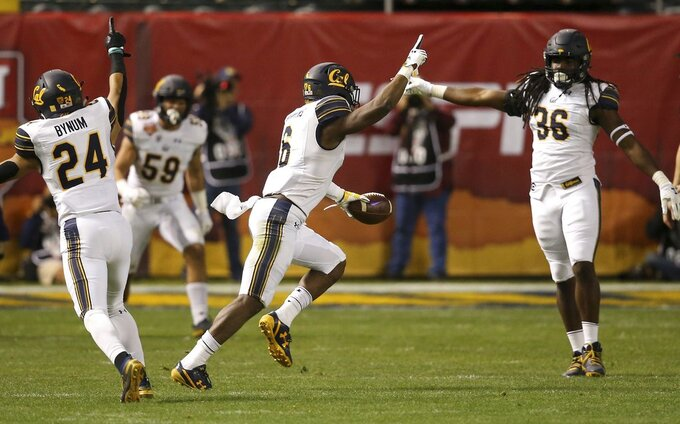 California safety Jaylinn Hawkins (6) celebrates his interception against TCU with linebacker Alex Funches (36) and cornerback Camryn Bynum (24) as linebacker Jordan Kunaszyk (59) watches during the first half of the Cheez-It Bowl NCAA college football game Wednesday, Dec. 26, 2018, in Phoenix. (AP Photo/Ross D. Franklin)