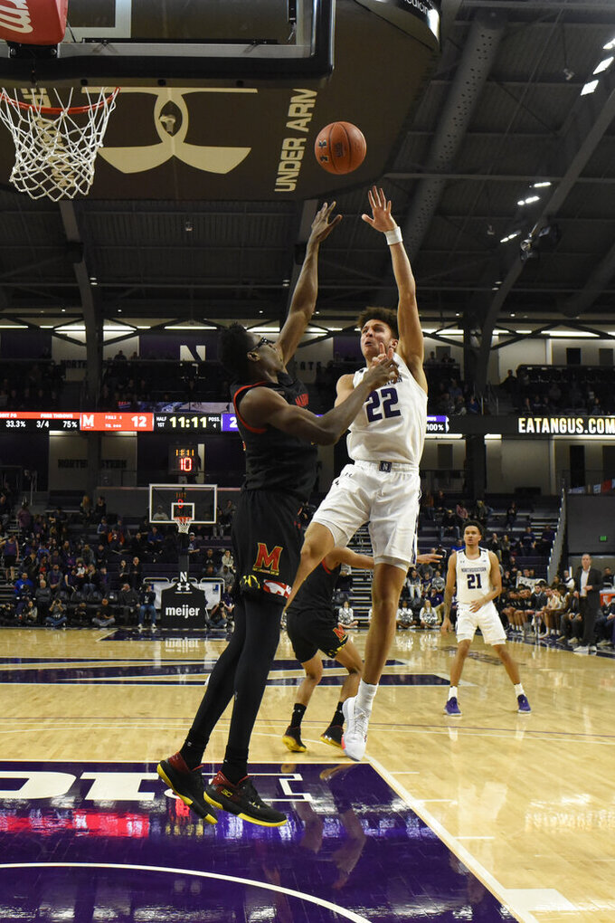 Northwestern forward Pete Nance (22) shoots over Maryland forward Jalen Smith (25) during the first half of an NCAA college basketball game, Tuesday, Jan. 21, 2020, in Evanston, Ill. (AP Photo/David Banks)