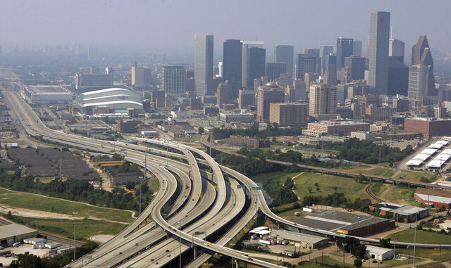 FILE - This Sept. 22, 2005 file photo shows Houston, Texas. Three metro areas in the Lone Star State had some of the biggest population gains over the past decade, according to figures released Thursday, March 26, 2020, by the U.S. Census Bureau. Dallas increased by 1.2 million people, the most of any U.S. metro area, followed by Houston, which added another 1.1 million residents over the decade. Austin grew by more than a half million residents from 2010 to 2019, the eighth biggest numeric growth among U.S. metros, according to the bureau's population estimates.(AP Photo/Pat Sullivan, File)