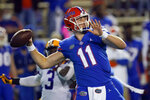 FILE - In this Dec. 12, 2020, file photo, Florida quarterback Kyle Trask (11) throws a pass against LSU during the first half of an NCAA college football game in Gainesville, Fla. Trask has been named a finalist for the Heisman Trophy. The Heisman will be awarded Jan. 5 during a virtual ceremony as the pandemic forced the cancellation of the usual trip to New York that for the presentation that usually comes with being a finalist. (AP Photo/John Raoux, File)