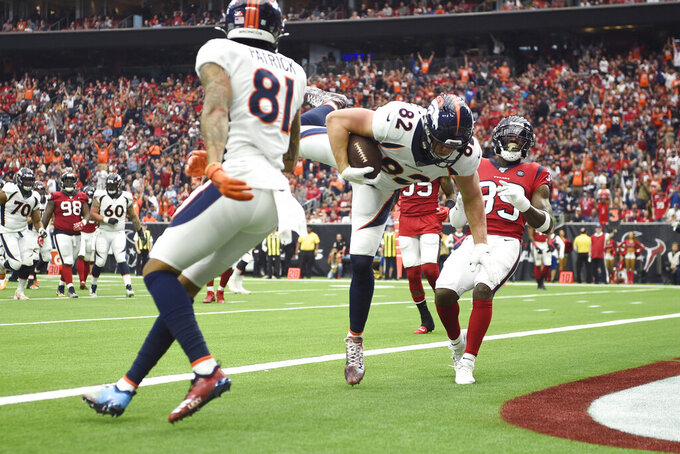 Denver Broncos tight end Jeff Heuerman (82) scores a touchdown against the Houston Texans during the first half of an NFL football game Sunday, Dec. 8, 2019, in Houston. (AP Photo/Eric Christian Smith)