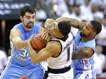 North Carolina forward Luke Maye (32) and guard Seventh Woods (0) battle Louisville guard Christen Cunningham (1) for the ball during the first half of an NCAA college basketball game in Louisville, Ky., Saturday, Feb. 2, 2019. (AP Photo/Timothy D. Easley)