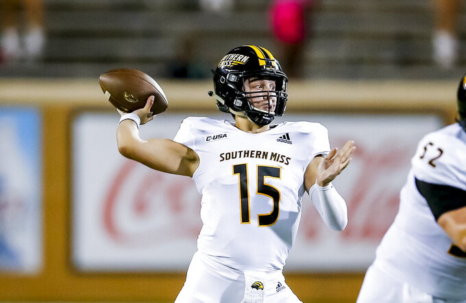 Southern Mississippi quarterback Jack Abraham (15) throws during the first half of an NCAA college football game against North Texas on Saturday, Oct. 3, 2020, in Denton, Texas. (AP Photo/Brandon Wade)