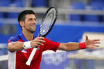 Novak Djokovic, of Serbia, gestures after defeating Jan-Lennard Struff, of Germany, in the second round of the tennis competition at the 2020 Summer Olympics, Monday, July 26, 2021, in Tokyo, Japan. (AP Photo/Patrick Semansky)