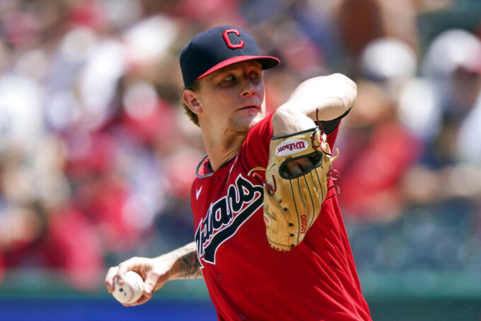 Cleveland Indians starting pitcher Zach Plesac throws in the first inning of a baseball game against the St. Louis Cardinals, Wednesday, July 28, 2021, in Cleveland. (AP Photo/Tony Dejak)