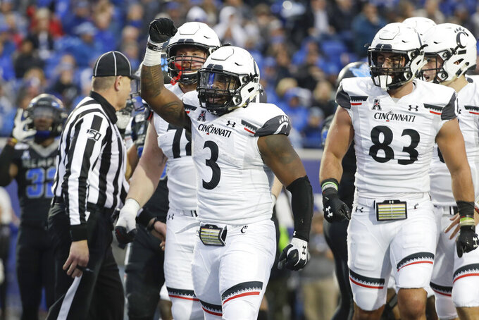 Cincinnati running back Michael Warren II (3) celebrates after scoring a touchdown against Memphis in the first half of an NCAA college football game Friday, Nov. 29, 2019, in Memphis, Tenn. (AP Photo/Mark Humphrey)