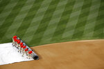 Grounds crew members roll a tarp over the infield during a rain delay before a baseball game between the Philadelphia Phillies and the Washington Nationals, Tuesday, June 18, 2019, in Washington. (AP Photo/Patrick Semansky)