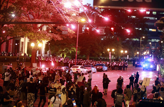 Police set off a crowd-dispersal firework in front of City Hall as several hundred people gather to protest over the death of George Floyd Friday, May 29, 2020, ion Columbus, Ohio. Floyd died in police custody Monday in Minneapolis.  (Doral Chenoweth/The Columbus Dispatch via AP)