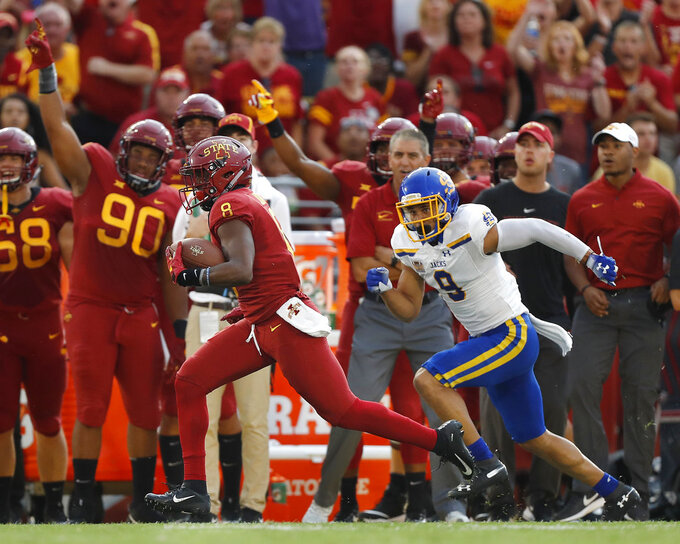Iowa State wide receiver Deshaunte Jones, left, breaks away from South Dakota State cornerback Jordan Brown, right, to score a touchdown during the first half of an NCAA college football game, Saturday, Sept. 1, 2018, in Ames, Iowa. (AP Photo/Matthew Putney)