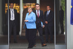 German Chancellor Angela Merkel, center, waits for the arrival of the Prime Minister of Finland Antti Rinne for talks at the chancellery in Berlin, Wednesday, July 10, 2019. (AP Photo/Markus Schreiber)