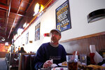 In this Wednesday, Jan. 30, 2019 photo, Phil Heidemann discusses whether or not he'll watch the upcoming Super Bowl while eating lunch at a sports bar in Fenton, Mo. St. Louisans may watch the game this weekend but few will be rooting for the Rams, the team that left the city for Los Angeles three years ago, leaving hard feelings and Rams owner Stan Kroenke and his team being even less popular than the Cubs. (AP Photo/Jeff Roberson)