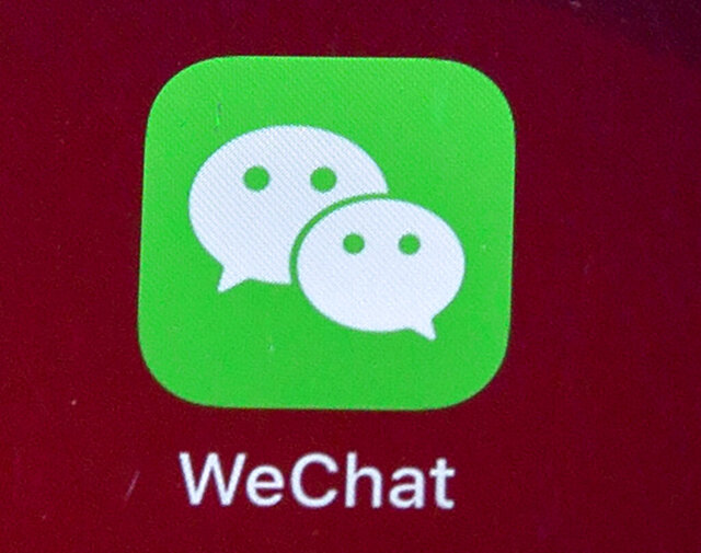 FILE - Icons for the smartphone apps WeChat are seen on a smartphone screen in Beijing, on Aug. 7, 2020.  The Justice Department is asking a judge to allow WeChat to be banned from app stores in the U.S., pending an appeal. In a Friday, Sept. 25, 2020 filing, the Justice Department requested U.S. Magistrate Judge Laurel Beeler in California put on hold a preliminary injunction issued Saturday. (AP Photo/Mark Schiefelbein, File)