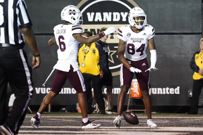 Mississippi State wide receiver Rara Thomas (84) celebrates with Jamire Calvin (6) after Thomas scored a touchdown against Vanderbilt in the second half of an NCAA college football game Saturday, Oct. 23, 2021, in Nashville, Tenn. (AP Photo/Mark Humphrey)