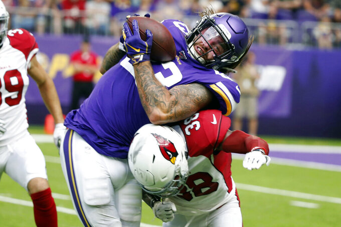 Minnesota Vikings tight end Tyler Conklin makes a reception over Arizona Cardinals safety Jalen Thompson (38) during the second half of an NFL preseason football game, Saturday, Aug. 24, 2019, in Minneapolis. (AP Photo/Bruce Kluckhohn)