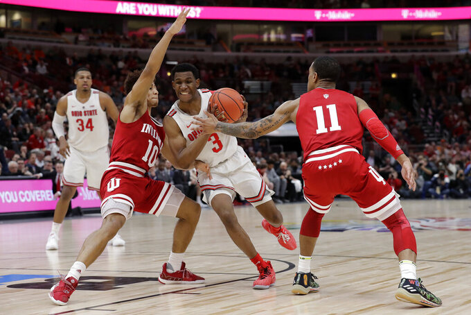 Ohio State's C.J. Jackson (3) drives against Indiana's Rob Phinisee (10) and Devonte Green during the second half of an NCAA college basketball game in the second round of the Big Ten Conference tournament, Thursday, March 14, 2019, in Chicago. (AP Photo/Nam Y. Huh)