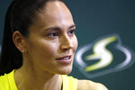 Seattle Storm's Sue Bird talks with media members at the basketball team's media day Monday, May 13, 2019, in Seattle. The Storm is the defending WNBA champion. (AP Photo/Elaine Thompson)