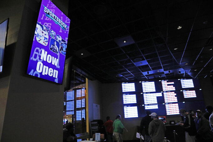 "In this Dec. 18, 2018 photo, a ""Now Open"" sign is displayed at the Pearl River Resort in Philadelphia, Miss. The sports book owned by the Mississippi Band of Choctaw Indians is the first to open on tribal lands outside of Nevada following a U.S. Supreme Court ruling earlier this year, a no-brainer business decision given the sports fans among its gambling clientele. (AP Photo/Rogelio V. Solis)"