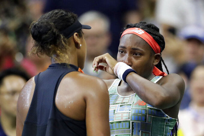 FILE - In this Aug. 31, 2019, file photo, Coco Gauff, right, of the United States, wipes away tears while talking to Naomi Osaka, of Japan, after Osaka defeated Gauff during the third round of the U.S. Open tennis tournament in New York. Two-time Grand Slam champion Naomi Osaka and 16-year-old Coco Gauff could face each other at the U.S. Open again after Thursday's, Aug. 27, 2020, draw for the Grand Slam tournament set up a possible third-round rematch.(AP Photo/Adam Hunger, File)