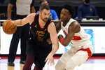 Cleveland Cavaliers forward Kevin Love (0) drives around Toronto Raptors forward OG Anunoby (3) during the first half of an NBA basketball game Monday, April 26, 2021, in Tampa, Fla. (AP Photo/Chris O'Meara)