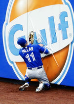 Toronto Blue Jays center fielder Kevin Pillar catches a ball hit by New York Mets' Michael Conforto for an out as he hits the wall during the second inning of a baseball game Wednesday, May 16, 2018, in New York. (AP Photo/Frank Franklin II)