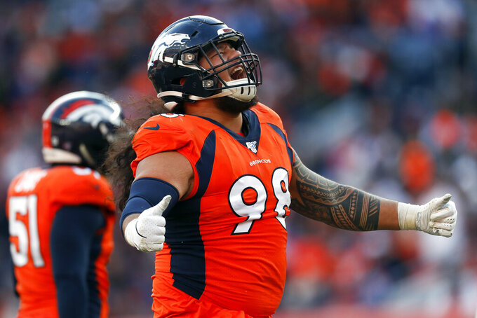 Denver Broncos nose tackle Mike Purcell reacts during the first half of an NFL football game against the Oakland Raiders, Sunday, Dec. 29, 2019, in Denver. (AP Photo/David Zalubowski)