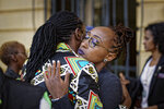 Activists from the LGBT community and their supporters commiserate after a ruling by the High Court in Nairobi, Kenya Friday, May 24, 2019. Kenya's High Court on Friday upheld sections of the penal code that criminalize same-sex relations, a disappointment for gay rights activists across Africa where dozens of countries have similar laws. (AP Photo/Ben Curtis)