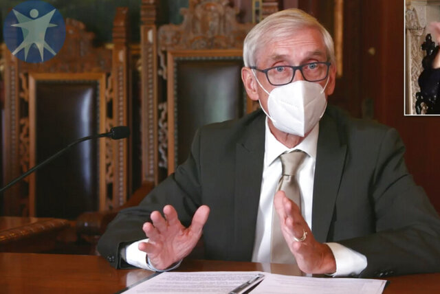 This image taken from video by the Wisconsin Department of Health Services shows Wisconsin Gov. Tony Evers on Thursday, July 30, 2020, in Madison, Wis. Evers issued a statewide mask mandate amid a spike in coronavirus cases. (Wisconsin Department of Health Services via the AP)