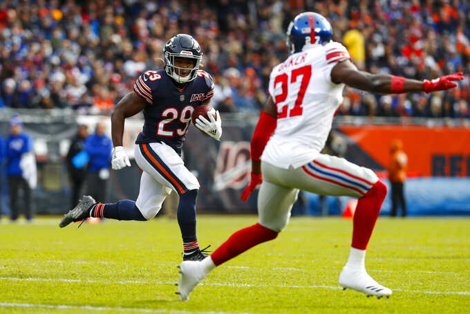 Chicago Bears running back Tarik Cohen (29) looks to get past New York Giants cornerback Deandre Baker (27)] during the first half of an NFL football game in Chicago, Sunday, Nov. 24, 2019. (AP Photo/Paul Sancya)