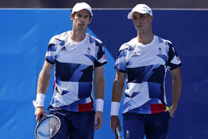The British doubles team of Joe Salisbury, right, and Andy Murray talk during the first round of the tennis competition at the 2020 Summer Olympics, Saturday, July 24, 2021, in Tokyo, Japan. (AP Photo/Seth Wenig)