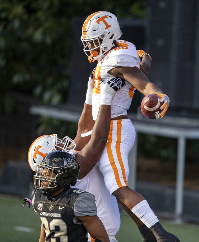 Tennessee tight end Princeton Fant (88) celebrates a touchdown with offensive lineman Jerome Carvin (75) as Vanderbilt cornerback Jaylen Mahoney (23) walks away during the first half of an NCAA college football game Saturday, Dec. 12, 2020, in Nashville, Tenn. (AP Photo/Wade Payne)