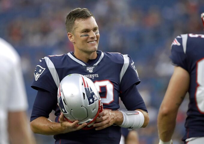 New England Patriots quarterback Tom Brady warms up before an NFL preseason football game against the Carolina Panthers, Thursday, Aug. 22, 2019, in Foxborough, Mass. (AP Photo/Elise Amendola)
