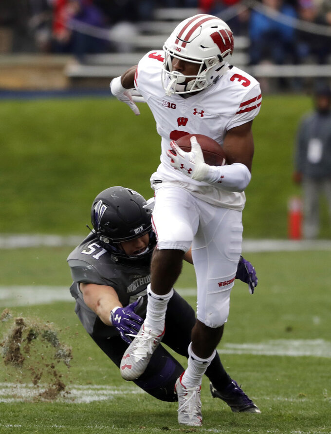 Wisconsin wide receiver Kendric Pryor (3) runs with the ball past Northwestern linebacker Blake Gallagher during the second half of an NCAA college football game in Evanston, Ill., Saturday, Oct. 27, 2018. Northwestern won 31-17. (AP Photo/Nam Y. Huh)