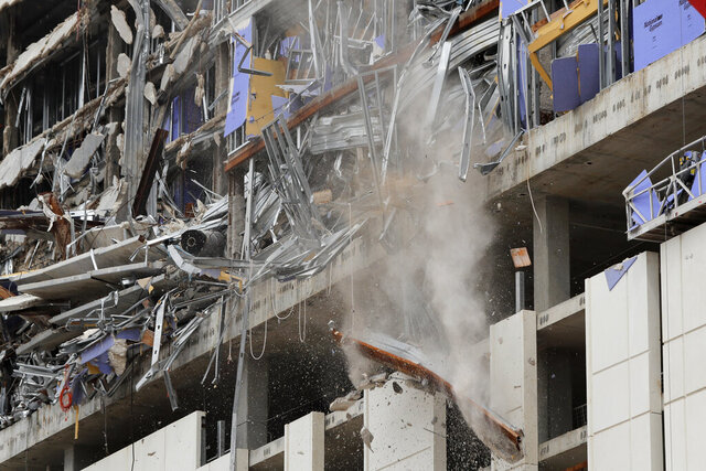 A wrecking ball knocks debris loose from the Hard Rock Hotel building collapse site in New Orleans, Monday, July 20, 2020. New Orleans' fire chief says it's taking longer than expected to remove the bodies of two construction workers from a hotel that partially collapsed during construction 10 months ago. Fire Superintendent Tim McConnell said that the first may be out by the end of this week and the other next week. (AP Photo/Gerald Herbert)