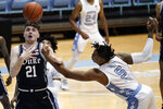 Duke forward Matthew Hurt (21) and North Carolina forward Armando Bacot (5) reach for the ball during the first half of an NCAA college basketball game in Chapel Hill, N.C., Saturday, March 6, 2021. (AP Photo/Gerry Broome)