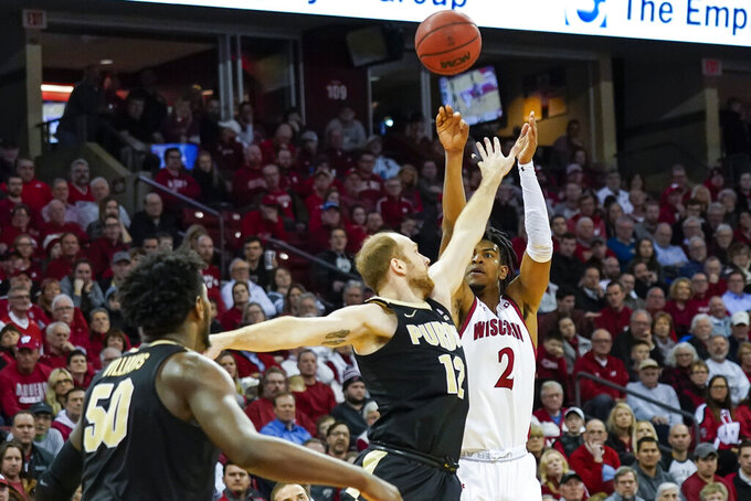 Wisconsin's Aleem Ford (2) shoots over Purdue's Evan Boudreaux (12) during the second half of an NCAA college basketball game Tuesday, Feb. 18, 2020, in Madison, Wis. Ford had a game-high 19 points in Wisconsin's 69-65 win. (AP Photo/Andy Manis)