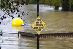 A sign warning of possible floodwaters at the entrance to Alton Baker Park in Eugene, Ore., proves to be an understatement, Monday, April 8, 2019, as water from the nearby Willamette River spills out into the park. (Chris Pietsch/The Register-Guard via AP)