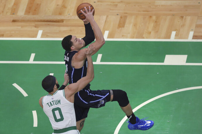 Orlando Magic forward Aaron Gordon drives to the basket past Boston Celtics forward Jayson Tatum (0) during the first quarter of an NBA basketball game in Boston, Wednesday, Feb. 5, 2020. (AP Photo/Charles Krupa)