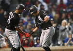Chicago White Sox's James McCann right, celebrates with Eloy Jimenez left, after hitting a solo home run during the fourth inning of the team's baseball game against the Chicago Cubs on Wednesday, June 19, 2019, at Wrigley Field in Chicago. (AP Photo/Paul Beaty)
