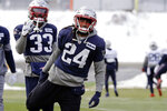 New England Patriots cornerback Stephon Gilmore (24) warms up near cornerback Joejuan Williams (33) during an NFL football practice, Wednesday, Dec. 4, 2019, in Foxborough, Mass. (AP Photo/Steven Senne)