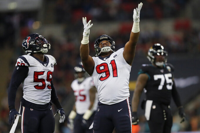 Houston Texans defensive end Carlos Watkins (91) celebrates during the second half of an NFL football game against the Jacksonville Jaguars at Wembley Stadium, Sunday, Nov. 3, 2019, in London. (AP Photo/Kirsty Wigglesworth)