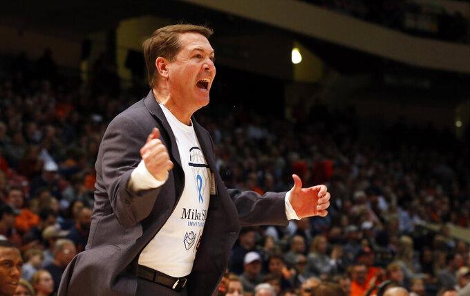 Saint Louis head coach Travis Ford reacts to a call during the first half of an NCAA college basketball game against Auburn, Saturday, Dec. 14, 2019, in Birmingham, Ala. (AP Photo/Butch Dill)