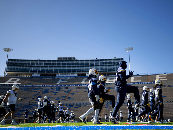 The Los Angeles Chargers warm up before the start of their high altitude practice at the Falcons Stadium at the United States Air Force Academy in Colorado Springs, Colo., on Tuesday, Nov. 12, 2019. The Chargers arrived in Colorado Springs on Monday and will spend the week practicing at the higher altitude at the Air Force Academy in preparation for Mexico City in next weeks' game against the Kansas City Chiefs. (Chancey Bush/The Gazette via AP)